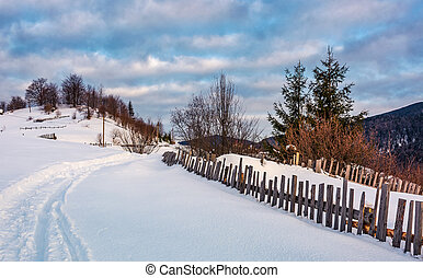 snowy path through rural area in mountains. lovely...