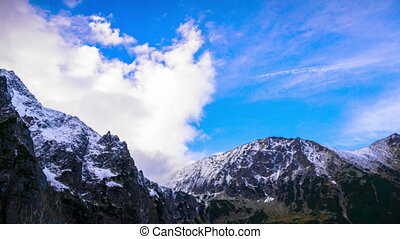 Snowy Peaks of Mountains with Clouds