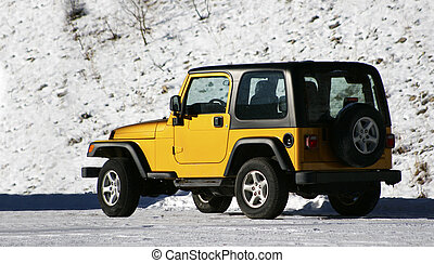 Snowy Road - Yellow SUV on a snowy road