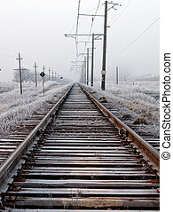 railroad - snowy scene on a sunset with railroad