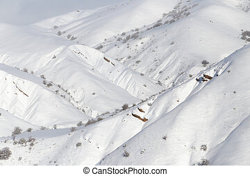 snowy slopes in the mountains