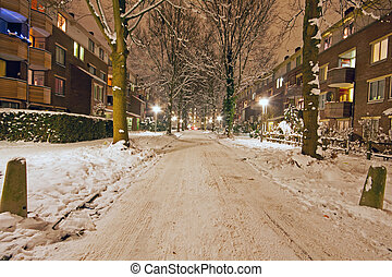 Snowy street in Amsterdam the Netherlands in winter at night