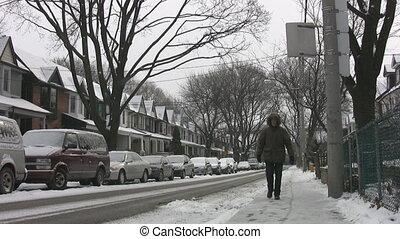 Snowy street with pedestrian.