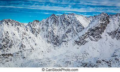 Snowy Tatra Mountains in winter and blue sky, Poland