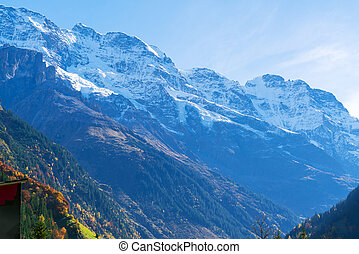 Snowy tops of Alps mountains in Berner Oberland
