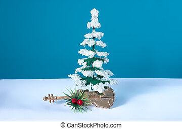 Snowy tree with violin