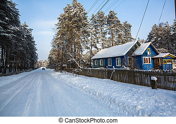 Snowy village outdoors in the Karelia at winter, Russia.