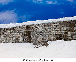 Snowy Wall with blue sky - Snowy stone wall with blue sky...