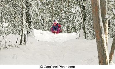 Snowy Weekend - Happy siblings sledding on a snowy weekend