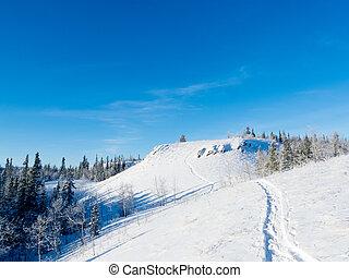 Snowy winter hills snowshoe track wonderland scene