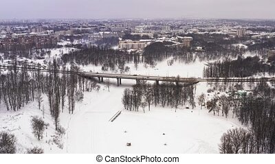 Snowy winter in beautiful city or town. Clip. Top view of...