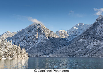 snowy winter landscape at austrian mountain lake