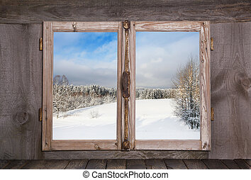 Snowy winter landscape. View out of an old rustic wooden...