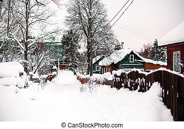 Snowy winter, on the street in the Russian village.