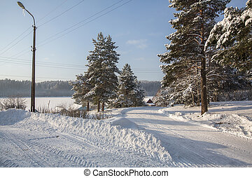 Snowy winter village outdoors in the Karelia Republic, Russia.