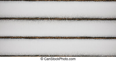 Snowy wooden planks background with copy space