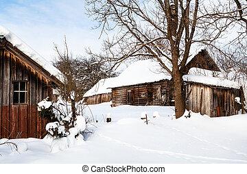 snowy yard in abandoned russian village in winter