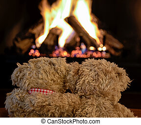 snuggling teddy bears by fireplace