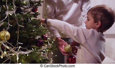 Nice little boy holding Christmas balls