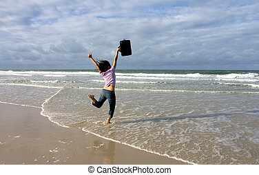 Woman with black suitcase jumping around