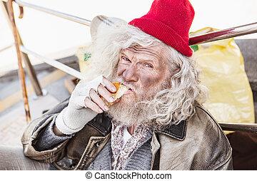 Aged poor man eating