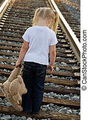 So Sad - Little girl with teddy bear on railroad tracks.