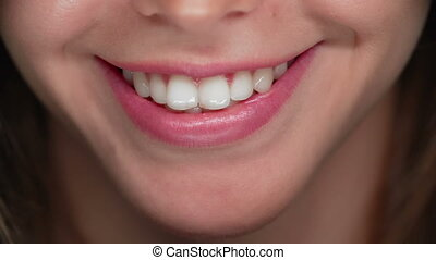 So Seductive - Extreme close up of female mouth smiling