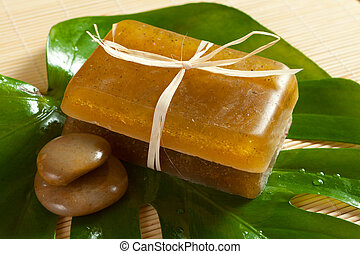 soap and stones on the leaf of a tropical plant