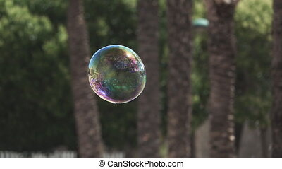 Soap bubble in the air, super slow motion