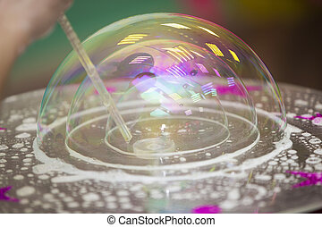 Soap bubble. Inflate the foam ball