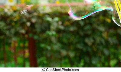 Soap bubble - Male blow soap bubbles, slow motion