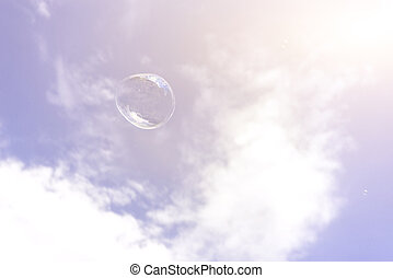 Soap bubble on the blue sky background
