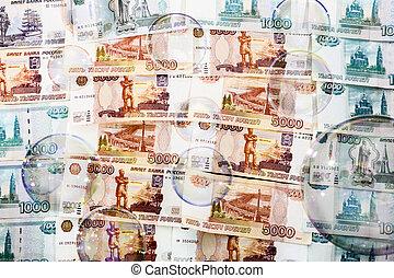 SOAP bubbles against a backdrop of us banknotes