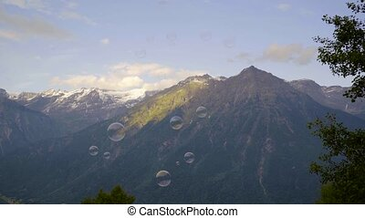 Soap bubbles against the background of the Swiss Alps.