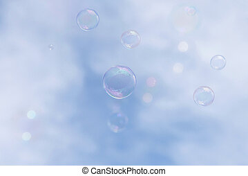 Soap bubbles floating up into the sky