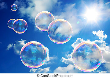 Soap bubbles on blue sky. Beauteful sunny day. Very nice color of the sky.