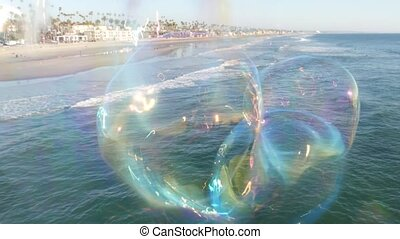 Soap bubbles on pier in California, blurred summertime seamless looped background. Creative romantic metaphor, concept of dreaming, happiness and magic. Abstract symbol of childhood, fantasy, freedom.