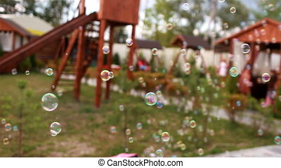 Soap bubbles on the background of the playground