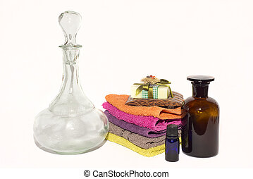 soap dish on top of facecloths with bottles