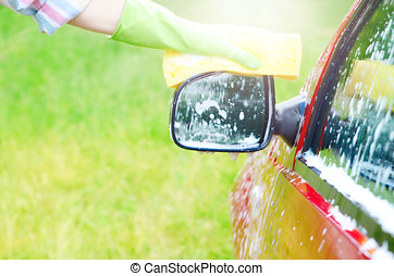 Soap foam on the car window and mirror. Car wash service concept. Place for text