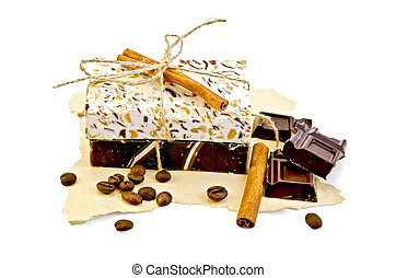 Soap homemade with chocolate and cinnamon on paper -...