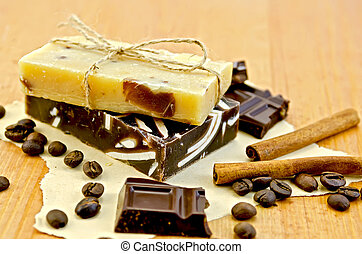Soap homemade with chocolate on paper and board - Two bars...