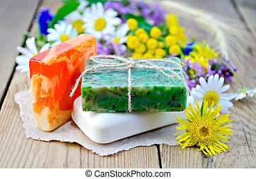 Soap homemade with wildflowers on the board - Three pieces...