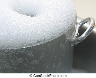 soap suds - Soap suds on the rim of a cooking pot.
