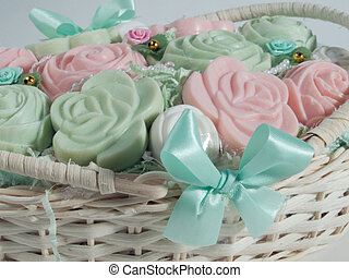 Soaps in the basket - Some rose and pastel soaps in a basket