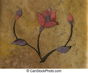 Soapstone Flower on a brown textured background