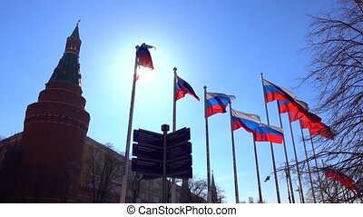 Soaring Russian flags near the Moscow Kremlin against sunny...