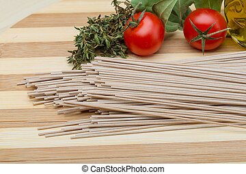 Soba - buckwheat pasta on the wood background