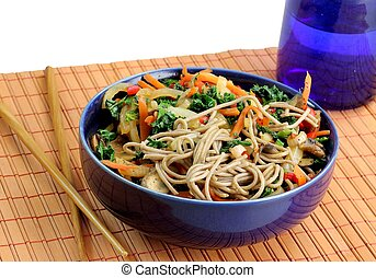 Soba noodles and stir-fried veggies - A closeup of a healthy...