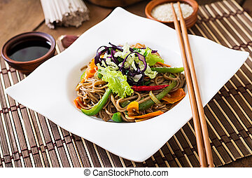 Soba noodles with beef, carrots, onions and sweet peppers.